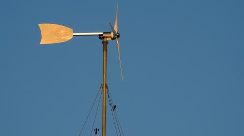 Small Wind Turbine Against Blue Sky